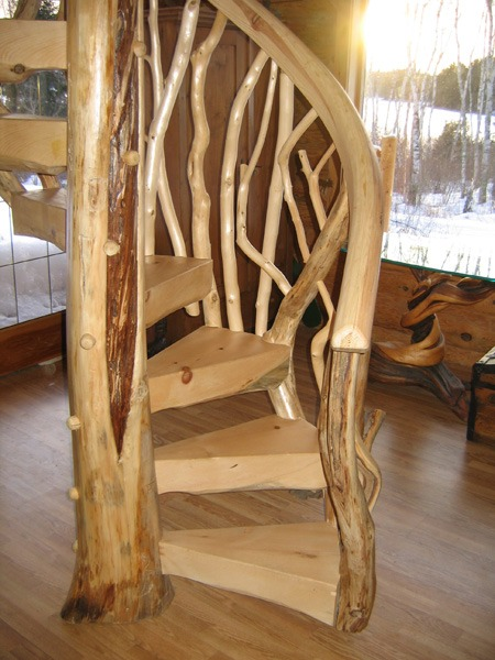 Custom wood spiral staircase by Ryan's Rustic Railings