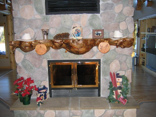 Custom fireplace mantel made from a tree by Ryan's Rustic Railings