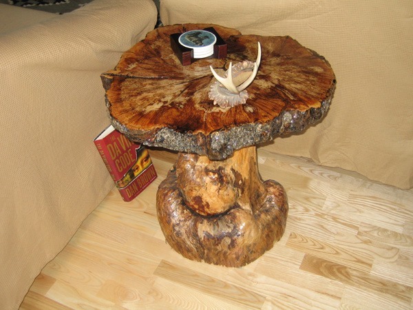 Wooden side table made from tree trunk and timber knot