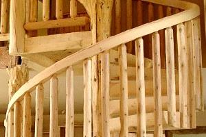 Natural wood spiral staircase