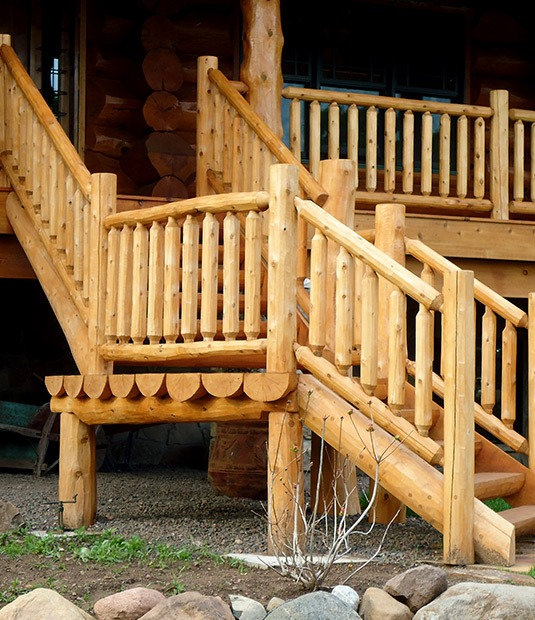 Custom wood log railing, outdoor porch and stairway