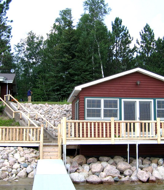 Outdoor wooden deck railing and rustic stair railing