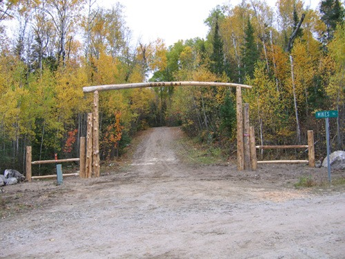 Wooden driveway log arch and fencing
