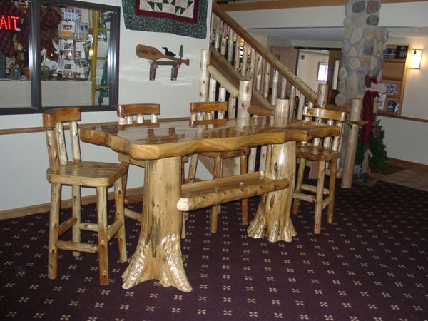 high-top table and wooden chair dining room set