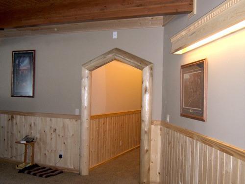 Custom wood paneling and trim by Ryan's Rustic Railings | trusses