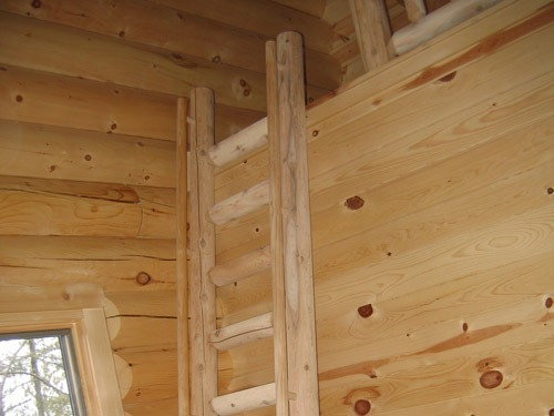 wood ladder to a loft   log staircases