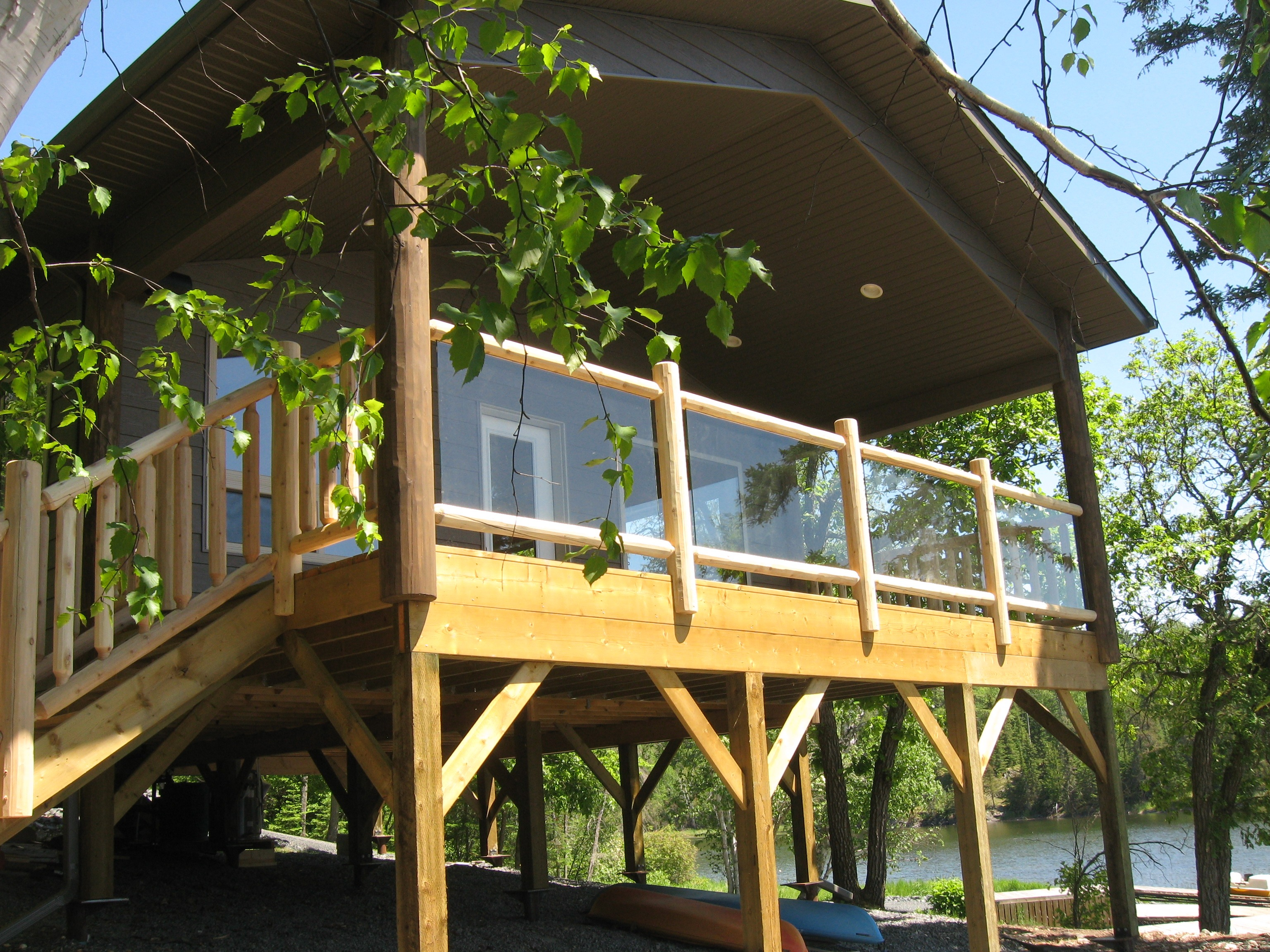 Wooden Railings with Glass Panels - Ryan's Rustic Railings